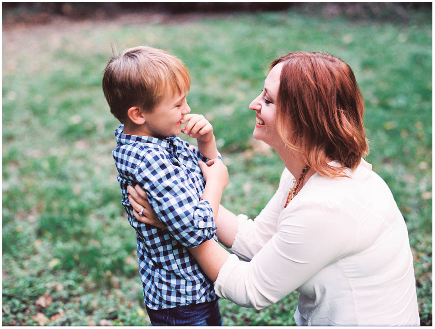 mom and son in blue checked shirt laughing film image