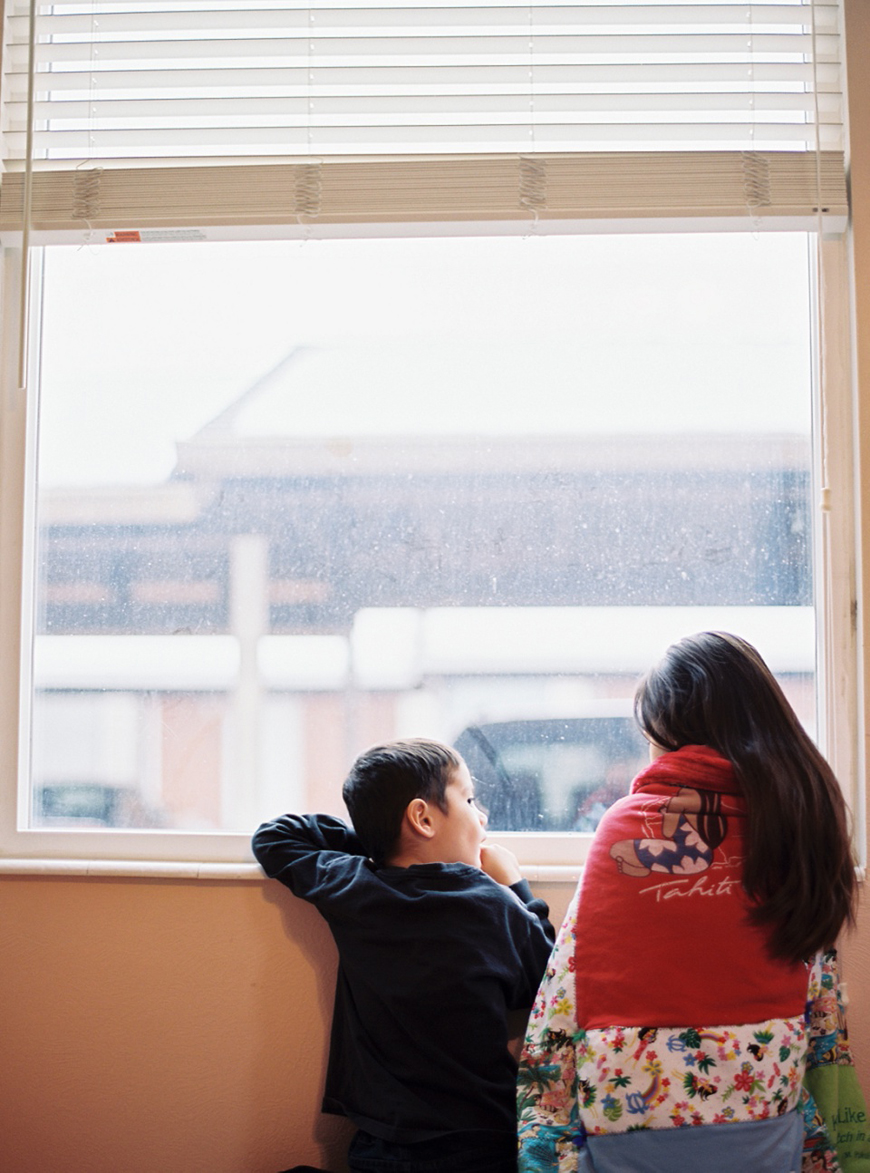 LeeYen lobendahn's image of brother and sister at window with blanket