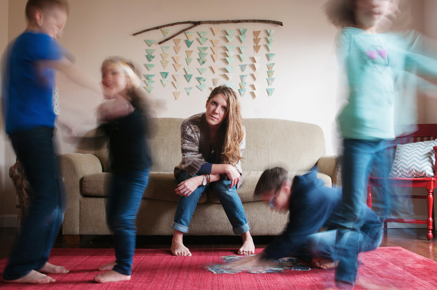 amazing image by alyssa anne photography of mom on couch with four kids running around