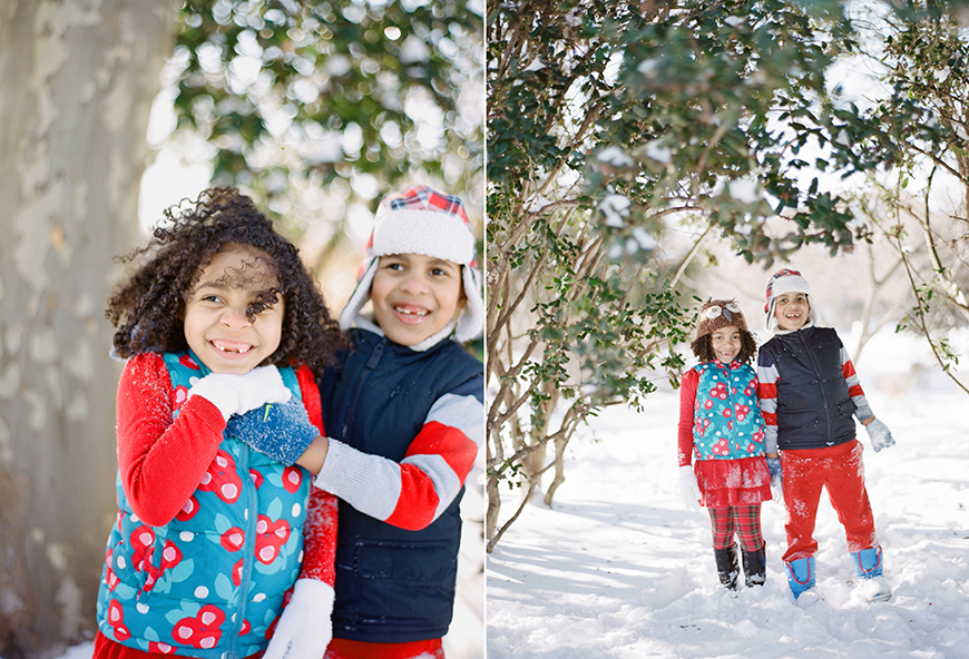 cute siblings in blue and red outfits in snow by audrey wrisley