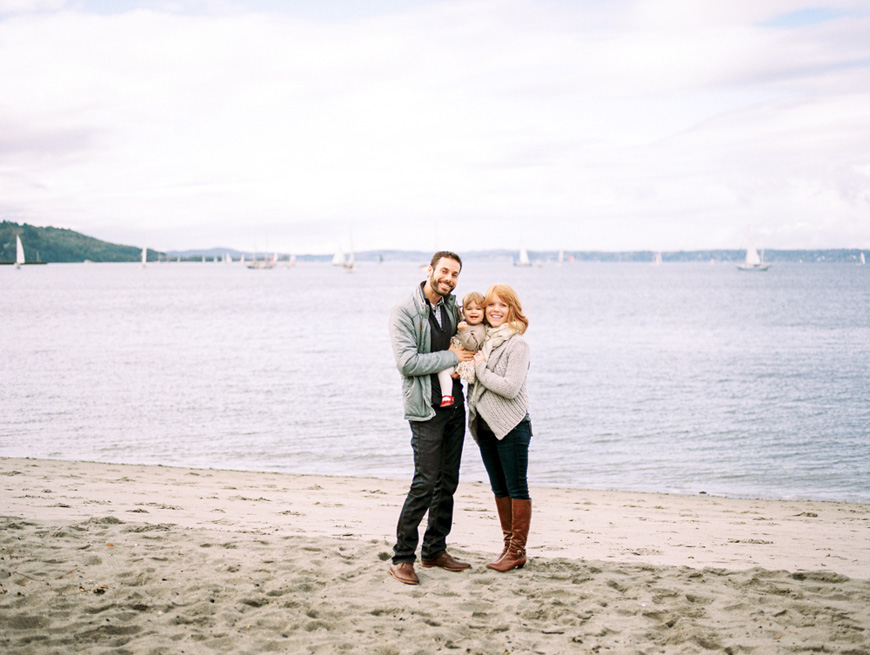 family on sf bay beach with boots and sweaters by photographer kim hildebrand