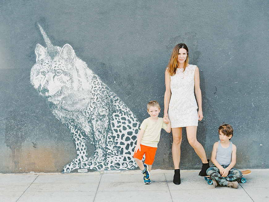 image by darcy benincosa of mom wtih two little boys on mural wall