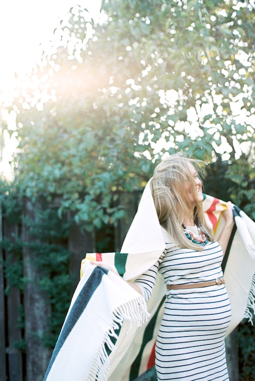 image by rachael kruse of woman in natural light backlight sun light with striped color blanket