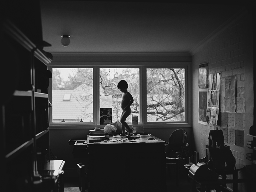 image by sarah black of black and white little boy dancing on desk