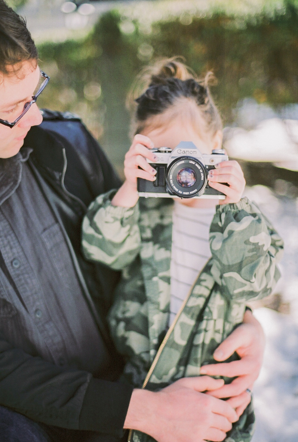 image by splendid musings photography of little girl holding camera