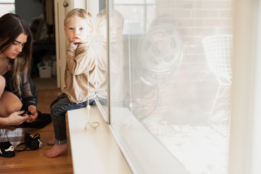 image of little boy on windowsill by jenifer fairchild