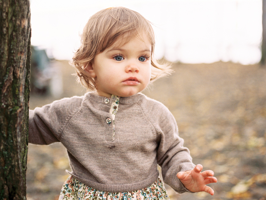 little girl in cute sweater on film in san francisco by photographer kim hildebrand