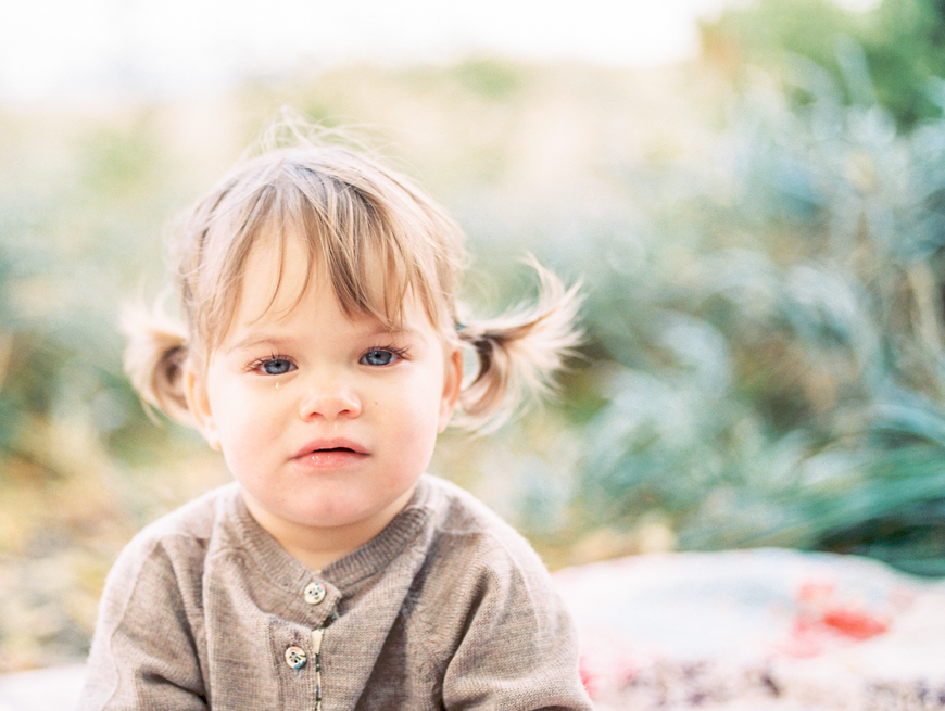 little girl in pig tails on film by photographer kim hildebrand