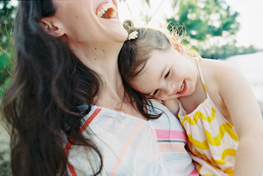 mom laughing with little girl snuggling image by wendy laurel