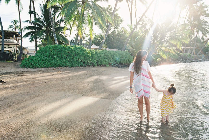 sunshine streaks palm trees mom and daughter photo