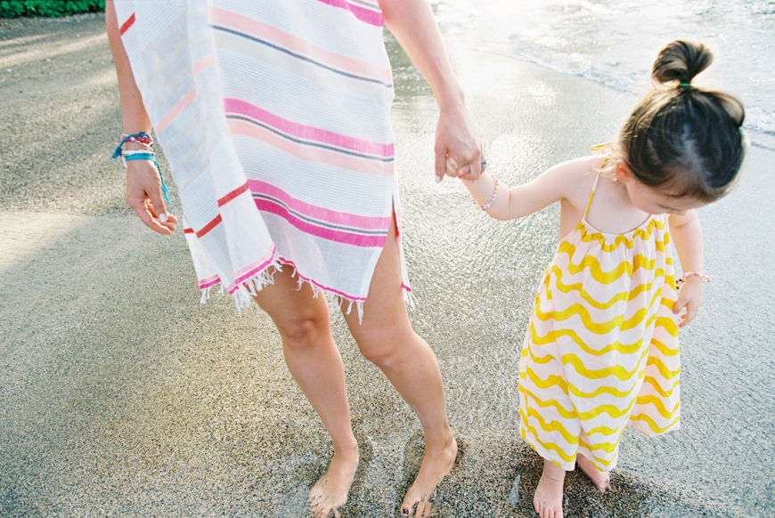stripes on mom and daughter holding hands image