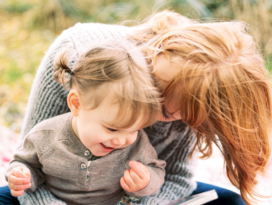 mom snuggling baby girl with laughter in sf by photographer kim hildrebrand