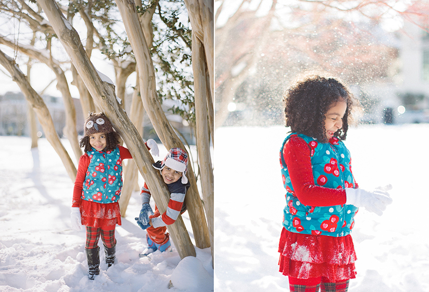 photo by virginia photographer audrey wrisley of girl in blue and red flowered snow jacket in snow
