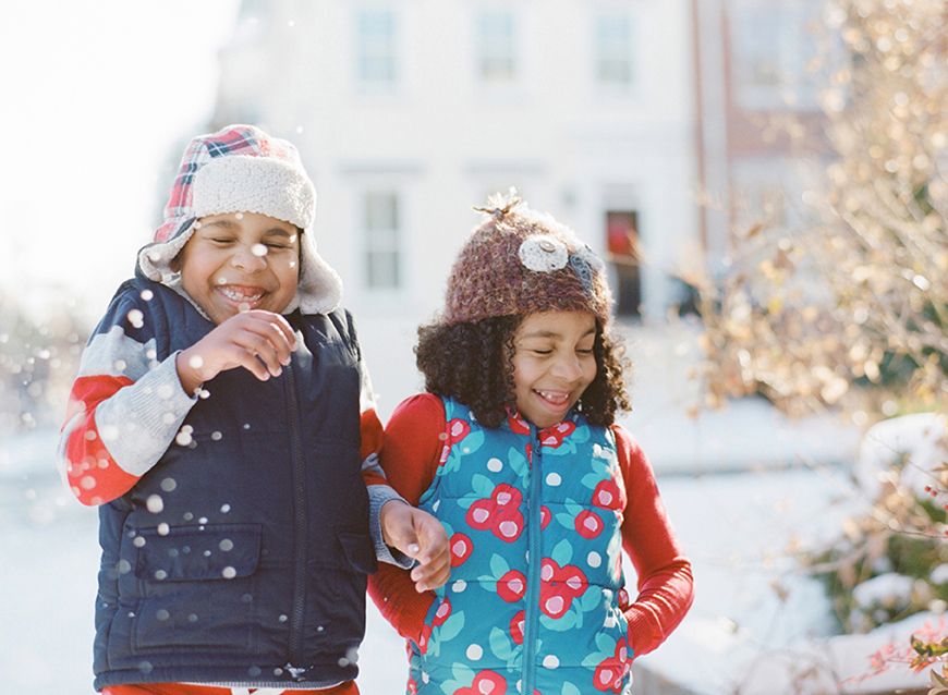 sister and brother photo laughing in snow by virginia photographer audrey wrisley