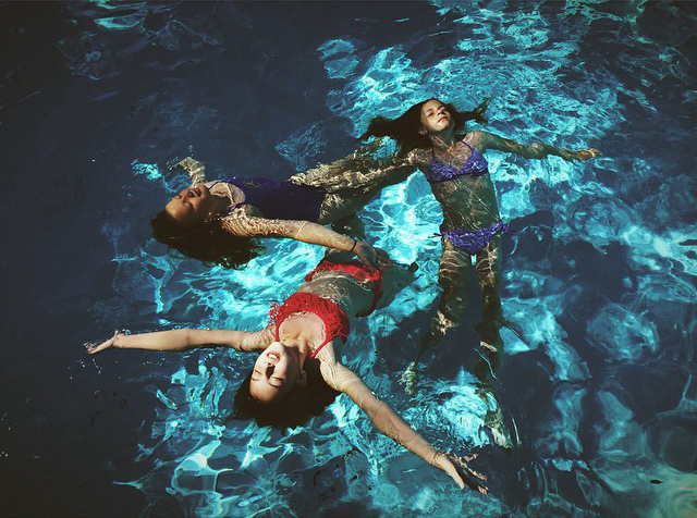 amy-graces-image-of-three-girls-in-a-pool-floating