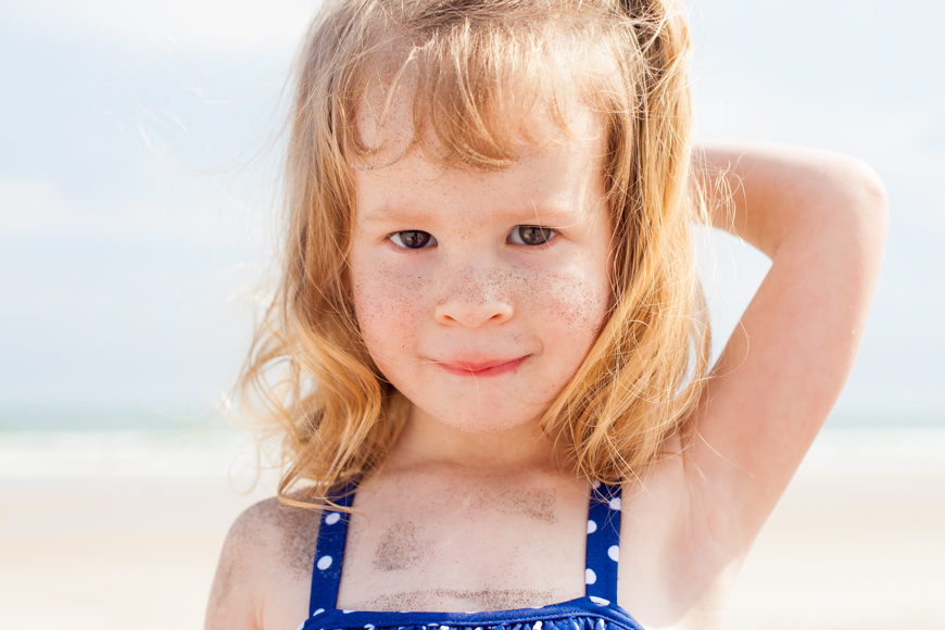 anna rasmussen's photo of red headed girl in blue polka dotted swim suit