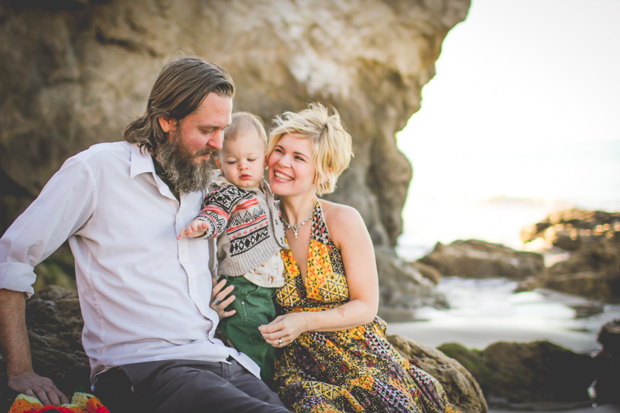 family laughing at cliffs with mom in yellow print dress by shannon alkin