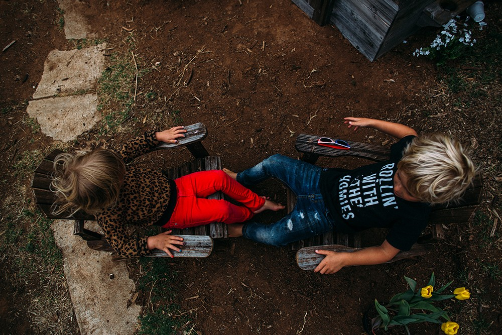 photo of a brother and sister shot from above by Tarah Sweeney