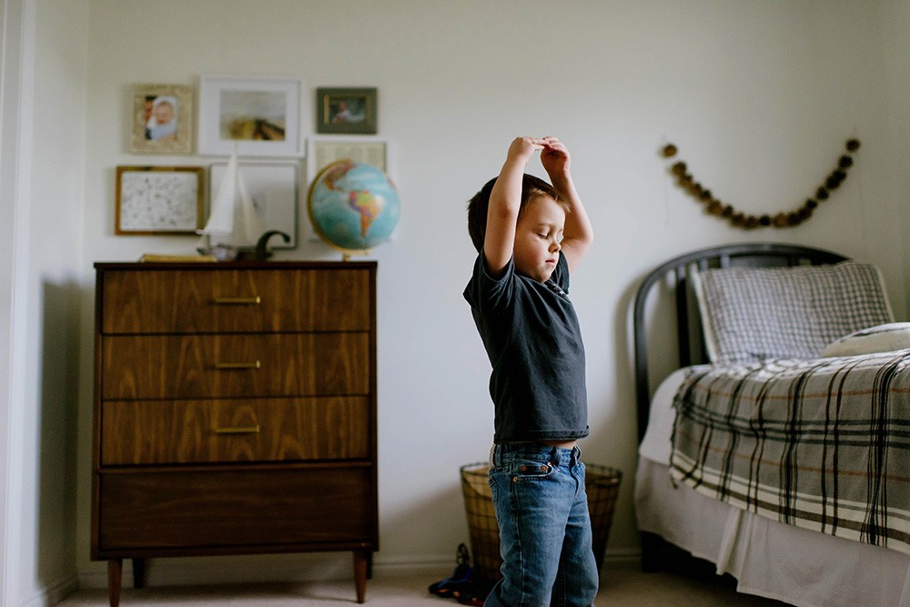 photo of boy dancing in a bedroom by Jessica Haderlie