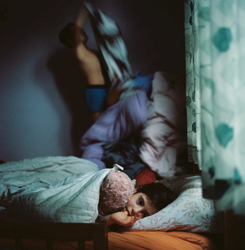 picture of boy laying in bed by Zalmy Berkowitz