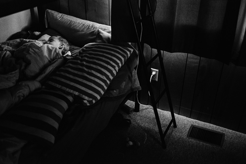roger ellsworth of ep love's black and white image of kid sleeping