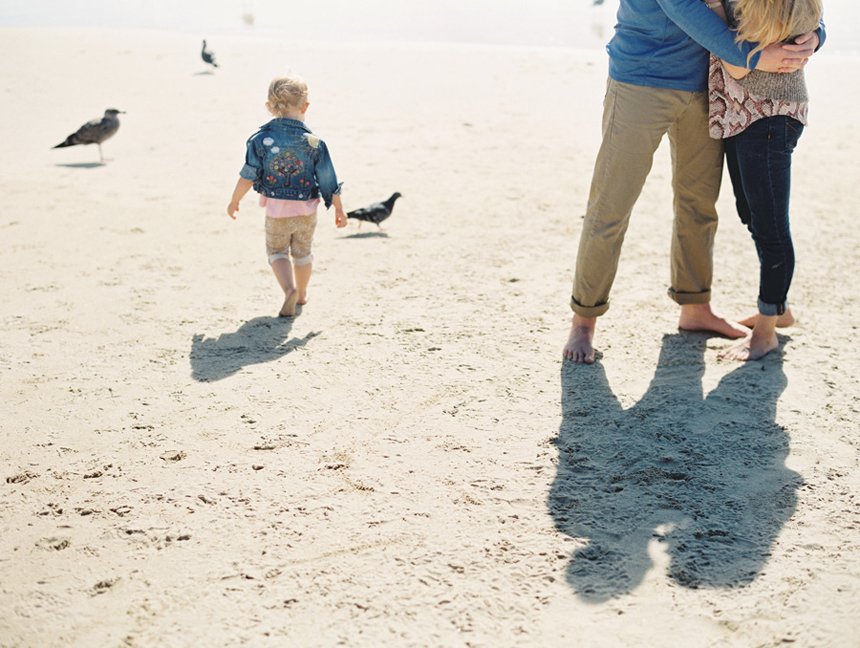 shadows of parents with little girl and seagulls by victoria oleary