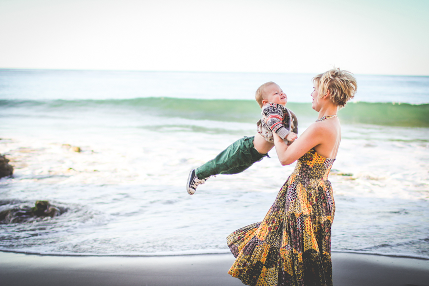 shannon alkin's image of mom swinging boy at beach