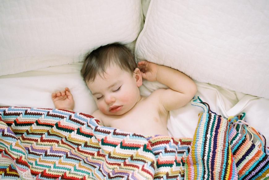toddler sleeping with a knitted blanket by Erin Holmes