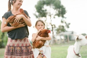 yan photo's image of family holding chickens