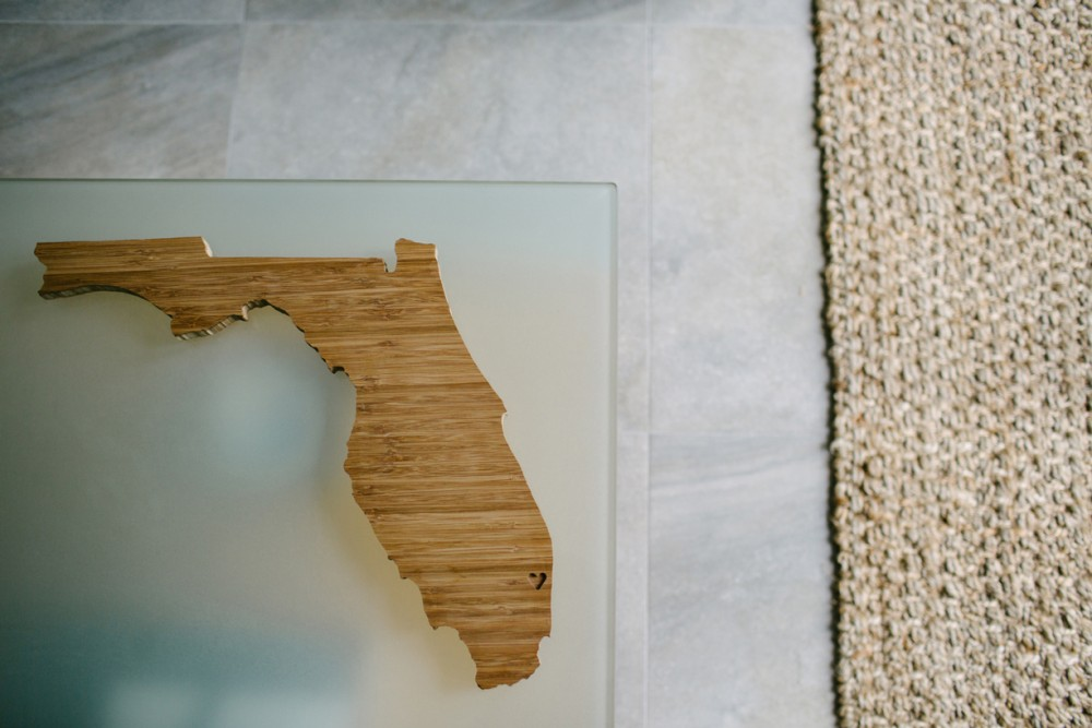 1 photo of carved wooden Florida on table by Lauren Mitchell