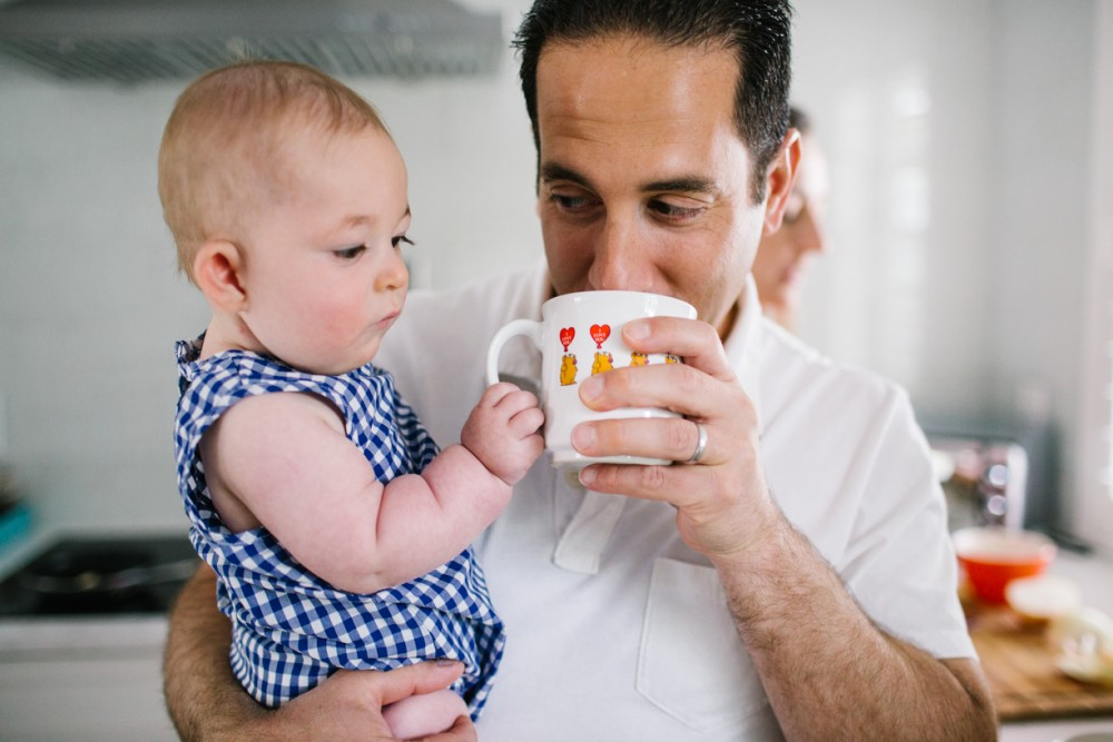 11 picture of father sipping out of mug holding baby wants drink by Lauren Mitchell