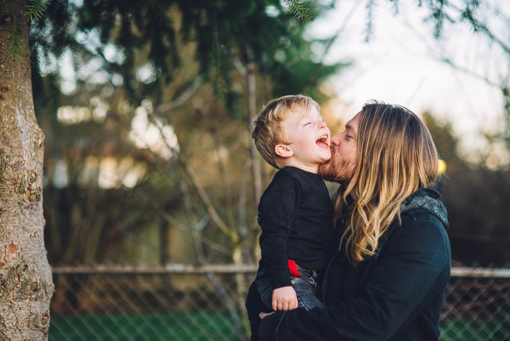 14 image of long-haired father holding kissing young son by devon michelle