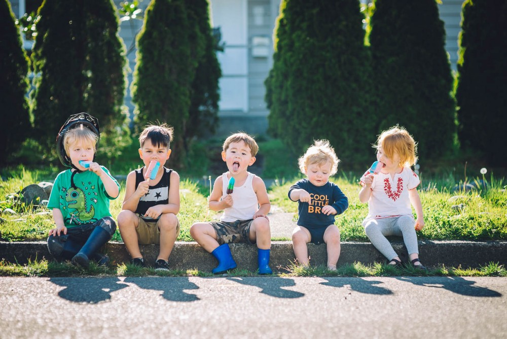 15 photo of five young kids sitting on curb eating popsicles in front of house by devon michelle