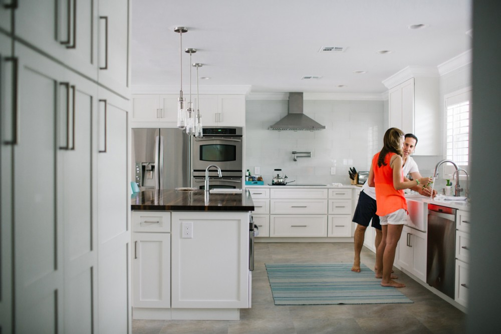 2 image of married couple in white kitchen delray beach florida by lauren mitchell