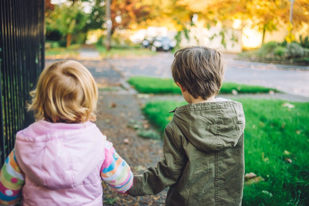 3 photo of a toddler boy and girl holding hands walking down street by devon michelle