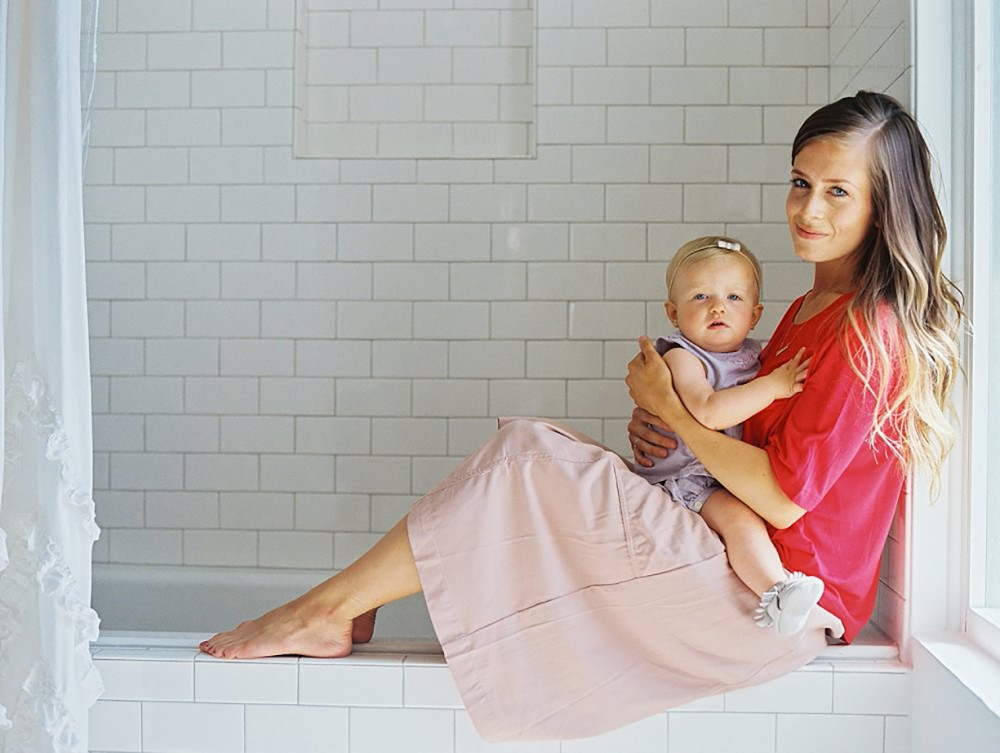3_ image of mother and toddler daughter sitting on edge of bath tub by Brooke Schultz