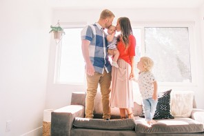 6_image of family of four standing on living room couch by Brooke Schultz