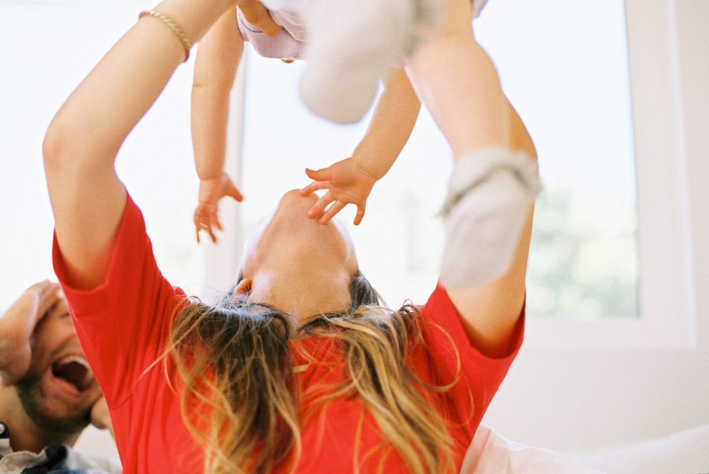 7_photo of mother holding daughter in the air close up by samantha kelly
