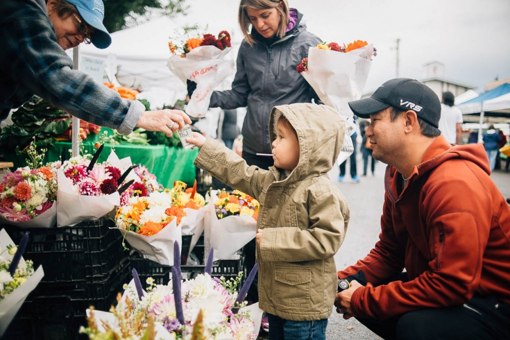 7b picture of young boy with father at florist paying for flowers by devon michelle