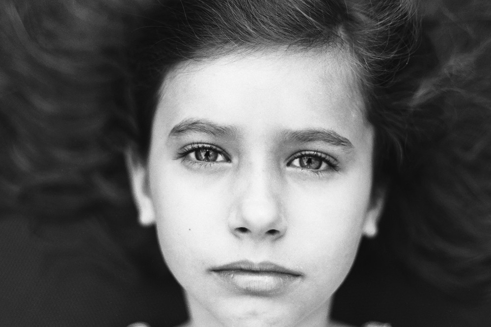 black and white close up portrait of young girl by kiera eve