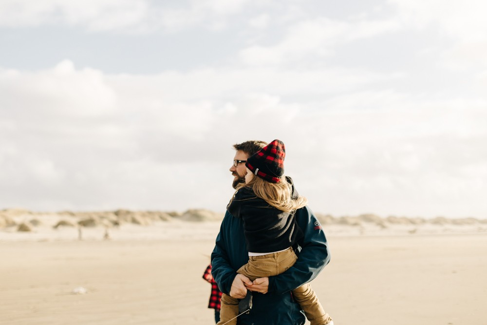 father and daughter on oregon coast beach by k dimoff photography