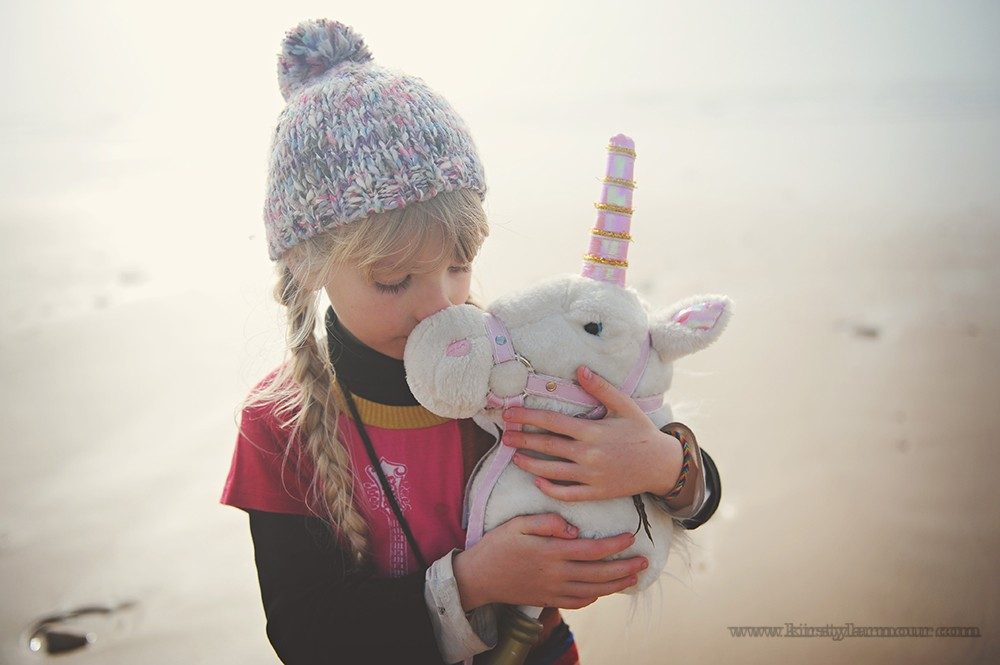 girl on beach in fog with stuffed unicorn by UAE photographer Kirsty Larmour 07
