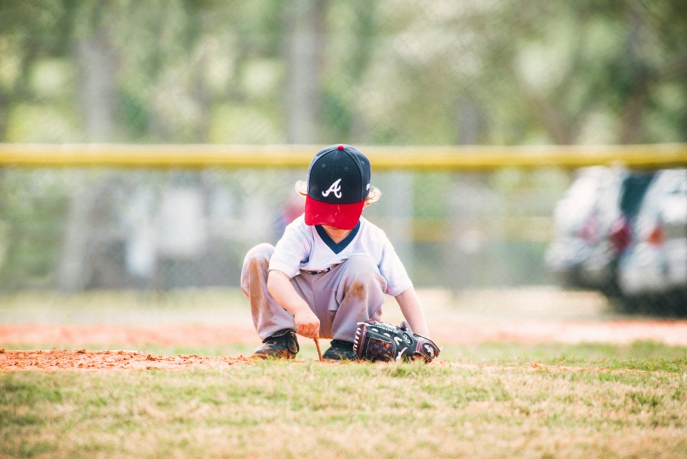 image of little kid playing in dirt on baseball field by Tabitha Brawley Kindled Photography