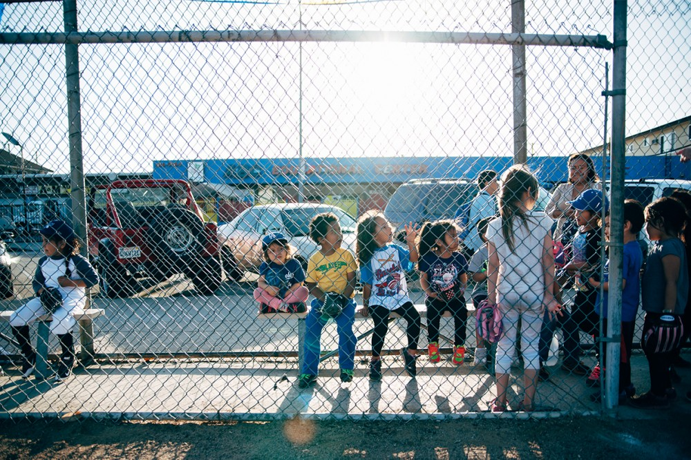image of young baseball team in dug out los angeles by carolyn brandt