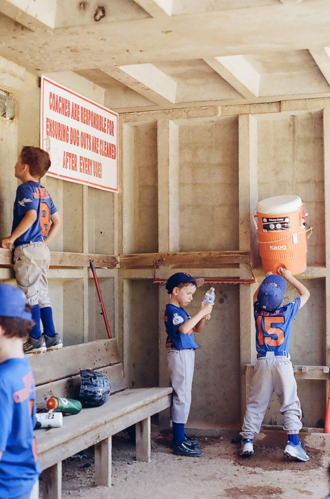 image of young boys in baseball dug out by carrie geddie