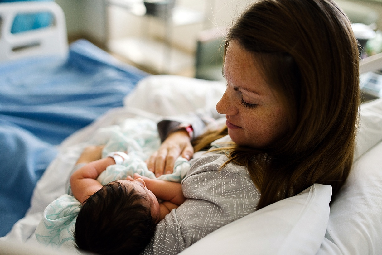photo of a new mom holding her baby by Bjorna Hoen
