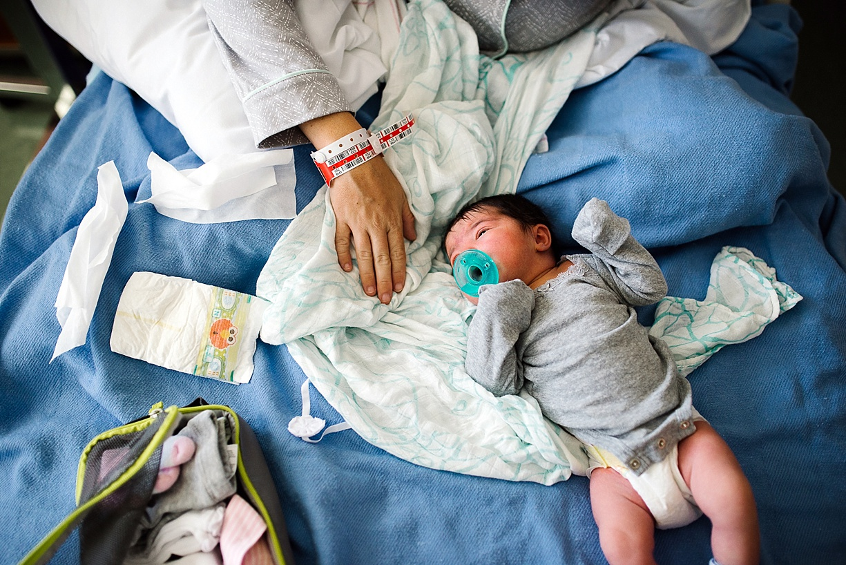 photo of a newborn with a pacifier by Thousand Oaks photographer Bjorna Hoen