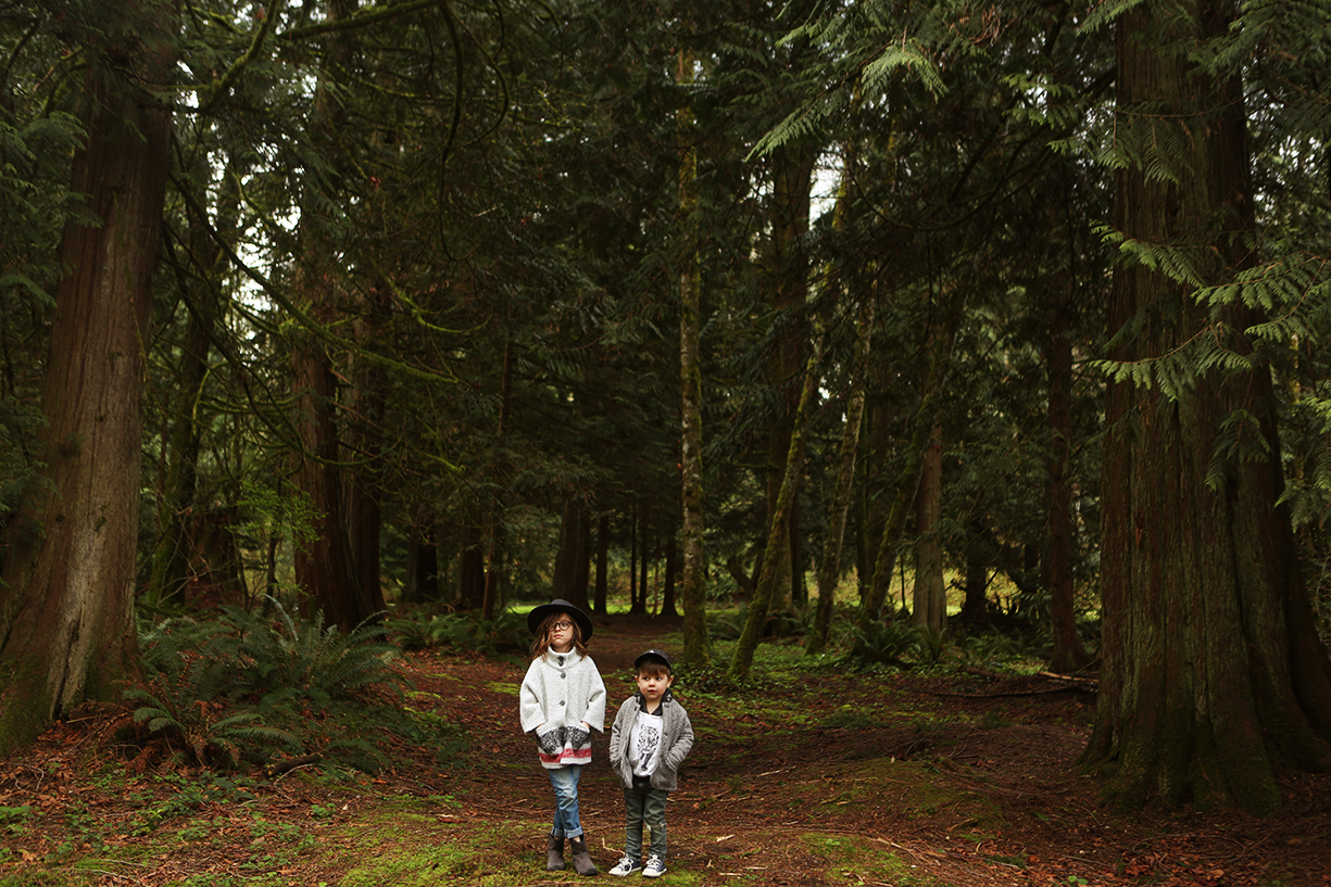 photo of brother and sister in woods by Andrea Hanki