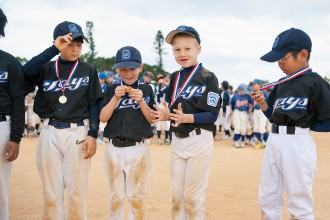 pic of four boys with medals in baseball uniforms by Meredith Novario