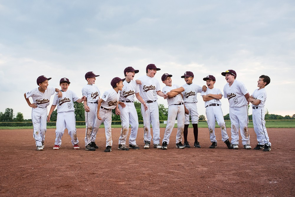 pic of little league baseball team laughing by kellie bieser